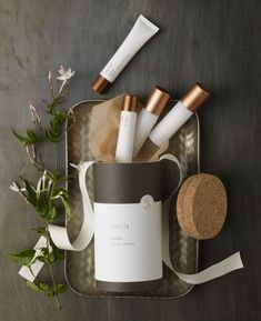Beautiful product shot. Vertical lines broken up with the playfully arranged cosmetic products. Potential props: trays, ribbon, brushes, greenery #naturalbeautyproductsphotography