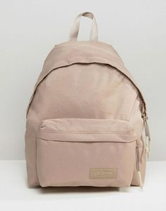 Wyoming beige backpack by Eastpak. Backpack by Eastpak Canvas outer Grab handle Padded straps for comfort External pocket Concealed ...
