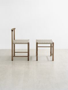 The 1925 FK02 Karnak chair and the FK03 Aswan in European walnut by Ferdinand Kramer, Now available as re-editions from the German furniture company E15. Shown here with the textile weave linen seating.