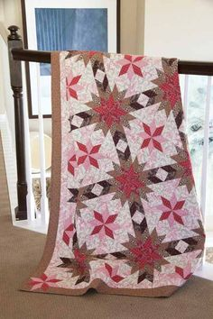 "Chocolate Covered Cherries Quilt Kit:  Make this classic quilt using the Chocolate and Cherries collection from Clothworks. This throw-sized quilt (52"" x 67"") designed by Will Bennett is sure to become a family treasure."