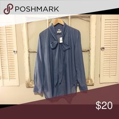 LOFT oversized denim shirt Still has original tags! I usually wear size small or medium shirts, but this size large oversized top looks super cute with leggings as well! LOFT Tops Blouses