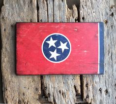 Our Tennessee State flag is created on reclaimed wood from barns and fallen structures in middle Tennessee. Sealed to last with metal hanger on back. *Available online at www.signniche.com