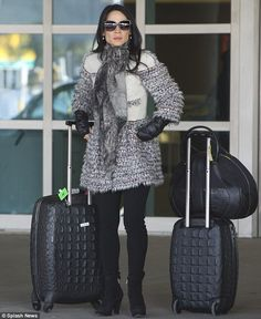 Effortlessly chic: Lucy Liu looked stunning in her outfit and matching luggage as she flew back to New York over the weekend