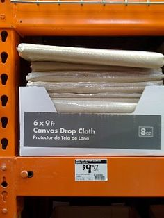 $10 canvas drop cloths from Home Depot. Great inexpensive fabric for curtains or crafty stuff.