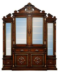 Beautiful antique 19th C. American Renaissance Revival bookcase and desk combination. This antique cabinet is executed in spectac