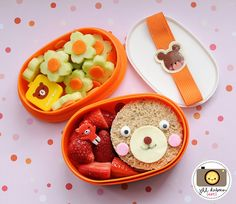 If you like this one, you'll want to come back for my giveaway tomorrow (hint, hint). This bento was for her afternoon break. She had a ham and cheese sandwich cut into a circle (using a juice cup). I made a cute little bear face using various cutters and cheese and fruit leather, icing eyes and food safe markers. She also had strawberries with a cute little bear pick and the top tier had flower cucumbers and carrots with a little bear container of dressing for dipping.    MEET THE DUBIENS