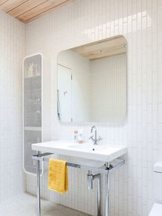Rectangular white ceramic bathroom tile, staggered vertical installation, rounded corners mirror, wood timber ceiling