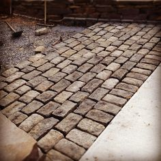 Last Friday, Dave & I took the day off and got to work laying our cobblestone driveway. The fact that we are delusional enough to do this . Front Driveway Ideas, Diy Driveway, Driveway Paving, Driveway Design, Paver Walkway, Driveway Entrance, Stone Walkway, Brick Pavers, Cobbled Driveway