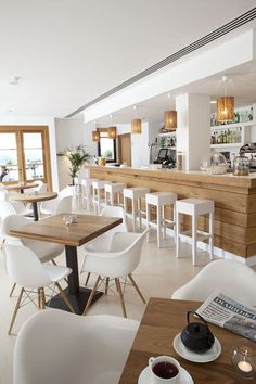 Summer style!!! White and neutral decor inspiration from a cafe -- so perfect for a kitchen at home too!
