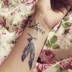 Franziskas Believe and feather tattoos.