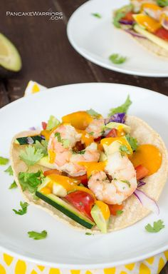 Shrimp tacos with a twist! These shrimp tacos are paired with a sweet and fiery sriracha mango sauce. This dish is ready in under 20 minutes. Perfect recipe for dinner or even lunch!  | www.pancakewarriors.com!