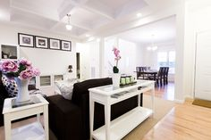 wonderful white open plan living room with black couch as impressive living room decor