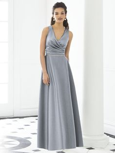 After Six Bridesmaid Style 6648  Sleeveless full length v-neck matte satin dress. Draped surplice bodice w/ modified circle skirt. Lux chiffon covered silver sequin belt always matches dress. Also available cocktail length as style 6647. Sizes available 00-30W, and 00-30W extra length.