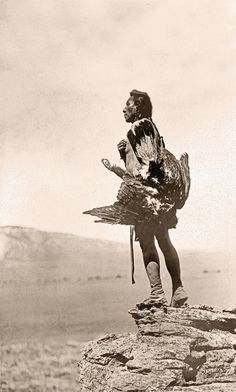 This powerful view of a Hidatsa holding an eagle as he stands on a large rock overlooking a valley conveys why so many Edward S. Curtis photographs speak to us today.  – Courtesy Library of Congress –