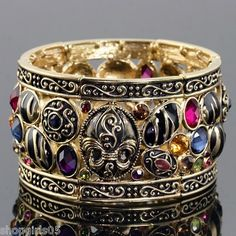 NEW! BEAUTIFUL!!  FLEUR DE LIS GOLD COLOR STRETCH BRACELETS.