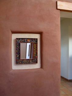 custom nicho in straw bale wall for artwork