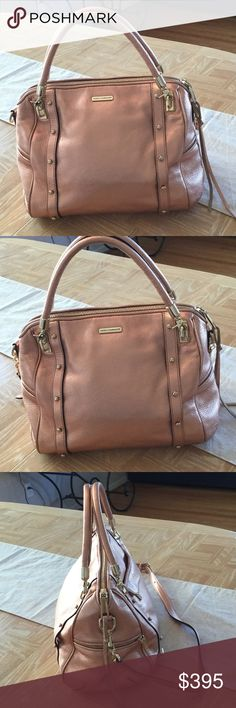 REBECCA MINKIOOFF CUPID, FULL SIZE, IN ROSE GOLD THIS IS A FULL SIZE REBECCA MINKOFF CUPID. THE LEATHER AND THE HARDWARE ARE A BEAUTIFUL RODE GOLD. HAS REMOVABLE CROSSBODY STRAP. ZIPPERED POCKET ON FRONT AND TWO ZIPPERED POCKETS ON SIDE. GREAT BAG FOR THE FALL AND HOLIDAYS.  NWOT. NEVER USED. PERFECT CONDITION. DUST BAG INCLUDED. Rebecca Minkoff Bags Satchels