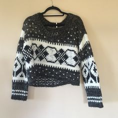 Free People Knit Cropped Sweater Black and white knit sweater. Soft & fuzzy. No runs. It hits a little above waist of regular jeans -- would look very cute with high wasted jeans. Worn but still good condition. Acrylic and wool. Free People Sweaters Crew & Scoop Necks