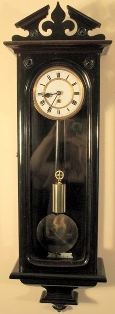 Earthtones...( Shades of brown and beige )---1860's weight driven Vienna wall clock.