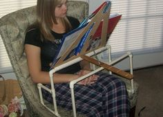 Adaptive book holder for people with weak upper extremities or high level spinal cord injuries. It also has a weighted book mark to hold pages open.