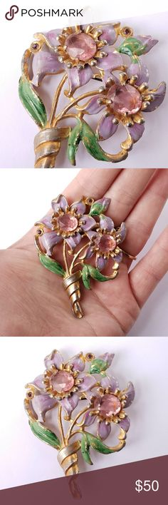 Vtg flower bouquet rhinestone brooch pin This gorgeous old flower bouquet brooch is made of gold tone pot metal with pretty paint and sparkly pink and purple rhinestones. It is in kind of shabby condition with some surface wear, which gives it charm! Dates from around 1940s. From a smoke free home. Offers are welcome:)    BeeF8846flower8885 Vintage Jewelry Brooches