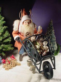 Santa's version of a motorcycle. Norma Decamp's santas  Ebay and Facebook