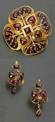 Art Nouveau gold and garnet brooch and a pair of earrings, by Němec Josef… via en.esbirky.cz