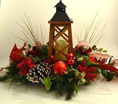 Christmas silk arrangement with lantern. Design by Fireside Flowers.