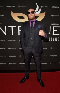 Conor McGregor on the red carpet in three piece suit with purple check shirt