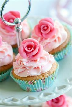 Lovely sponge cakes with pink icing and a pink sugared flower on the top. Simply beautiful for a vintage or summer wedding.