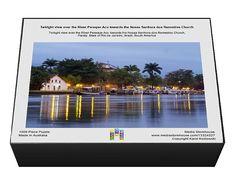 Twilight view over the River Pereque Acu towards the Nossa Senhora dos Remedios Church. 1000 Piece Puzzle. Twilight view over the River Pereque Acu t.
