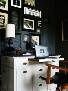 What a great idea to repurpose a cupboard into a desk for a laptop. It would be perfect in a living room or bedroom. The chair can move to the side, and computer stored in a drawer when not in use as a desk. The other drawers and cabinets would be perfect for additional storage. PLUS, the black walls are great:)