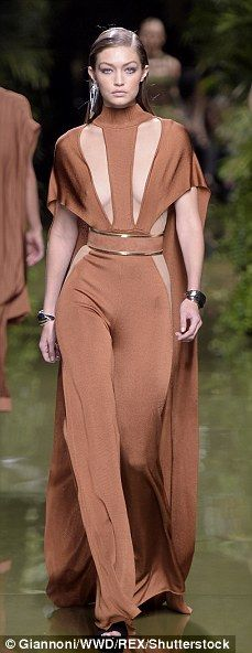 Giving them an Eiffel! Braless Gigi Hadid storms the runway in a risque cut-away jumpsuit as she joins scantily clad Constance Jablonski, Doutzen Kroes and Jourdan Dunn at the Balmain SS17 PFW show | Daily Mail Online