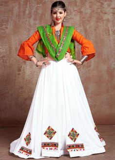 #white #embroidery #navaratri #lehenga #choli #dupatta #designs # traditional #indian #outfits #gorgeous #wedding #look #ootd #new #arrival #womenswear #online #shopping Cotton Lehenga, Lehenga Dupatta, Lehenga Blouse, Anarkali, Lehenga Crop Top, Kids Collection, Choli Designs, Party Wear Lehenga, Orange Fabric