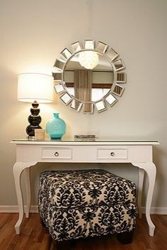 Big girls vanity table? With a big mirror leaned against the wall on top of the table....I think Yes!