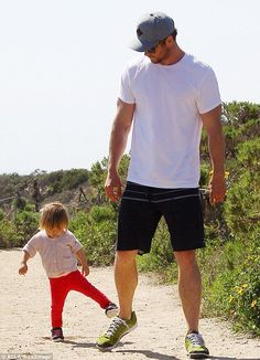 Hokey pokey: The 22-month-old toddler cutely kept in step with the Australian 30-year-old as they strolled down a scenic dirt path together