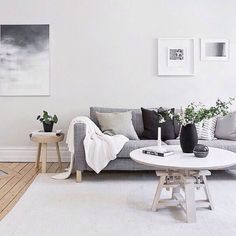 Love the grey couch, contrast against white and wood floors