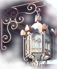 Rustica House decorative outdoor lantern was handmade of hammered iron. The lantern is available with oxidized finishing, unfinished or painted black. Candle Sconces, Wall Sconces, Rustic Wall Lighting, Hotel Foyer, Hacienda Homes, Metal Tins, Spanish Style, Ceiling Lamp, Outdoor Lantern