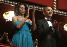 U.S. President Barack Obama and first lady Michelle Obama applaud the national anthem, played by trumpeter Arturo Sandoval (not pictured), as they arrive in their box for the 2013 Kennedy Center Honors at the Kennedy Center in Washington December 8, 2013. Musicians Herbie Hancock, Billy Joel and Carlos Santana, as well as opera singer Martina Arroyo and actress Shirley MacLaine are being honored this year for their lifetime contributions to American culture through the performing arts…