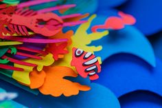 Colorful Layered Paper Cut Poster Depicting Ocean Pollution by Aline Houdé-Diebolt   strictlypaper