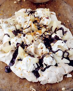 Tray-baked meringue with pears, cream, toasted hazelnuts and chocolate sauce - Jamie Oliver recipe