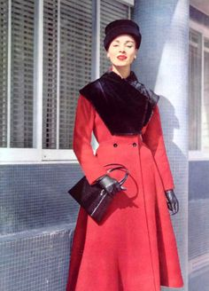 Model in red wool winter coat with bib-like collar of otter fur by Grès, croc handbag by Luciene Offenthal, cloche by Gilbert Orcel, photo by Pottier, 1956