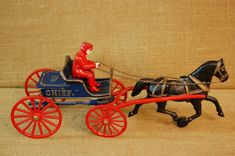 Vintage Cast Iron Fire Department Horse and Buggy, bright colors, no parts missing. Has hinged rear cover, chief on side, good condition. Measures 16 x 7 x Vintage Tools, Vintage Items, Farmhouse Kitchen Scales, Forte Apache, Cast Iron, It Cast, Furniture Quotes, Horse Cart, Horse And Buggy