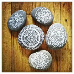 Mandala rocks by Sandeep Johal. This project was commissioned by a yoga instructor as a graduation gift for the yoga teachers-in-training she's mentoring. She also chose five words to write on the back of each rock for each set. What a gift!