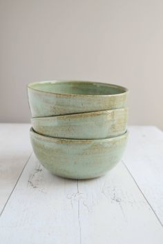 A personal favourite from my Etsy shop https://www.etsy.com/uk/listing/518213987/set-of-three-small-green-stoneware