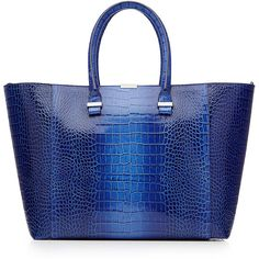 Victoria Beckham Textured Leather Tote ($1,750) ❤ liked on Polyvore featuring bags, handbags, tote bags, blue, metallic tote bags, blue tote, blue purse, blue handbags and metallic purse