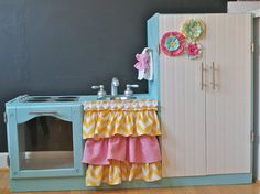 Adorable kitchenette made from an old entertainment center. This on is by far my favorite over all others I've seen done!