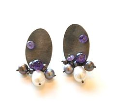 Marie Irene Weinz clips, with oxidized sterling silver, pearls and amethyst. Gallery Lulo.