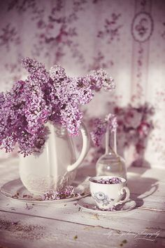 Lilacs of purple shades, white vase, what a lovely corner in the house.