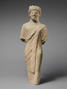 Limestone statuette of a beardless male votary in Greek dress with a wreath of leaves | Cypriot | Late Archaic–Early Classical, early 5th century B.C. | The Met